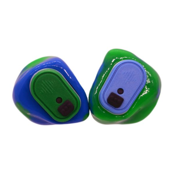 Opaque blue and neon green silicones with one light green and one light blue Vario Revolution module