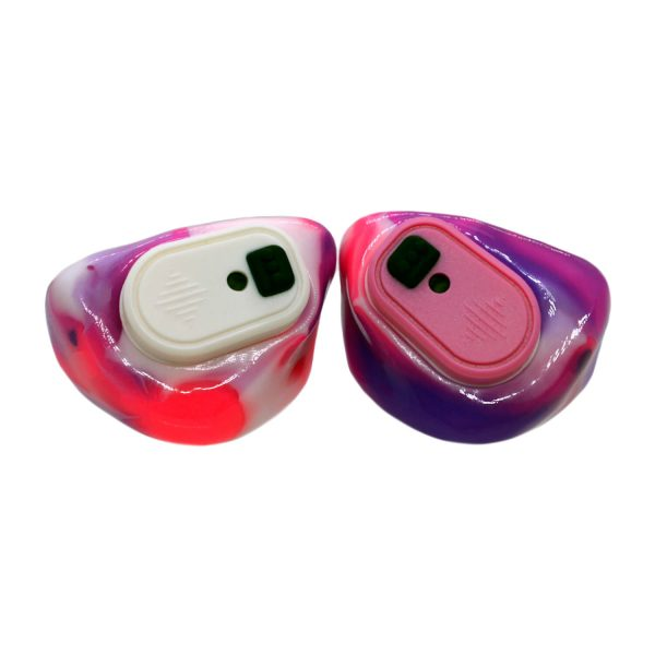 Neon pink, opaque purple and white silicones with one white and one pink Vario Revolution module